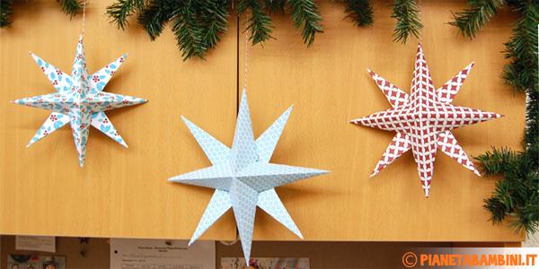 Stelle natalizie in rilievo da creare con la carta