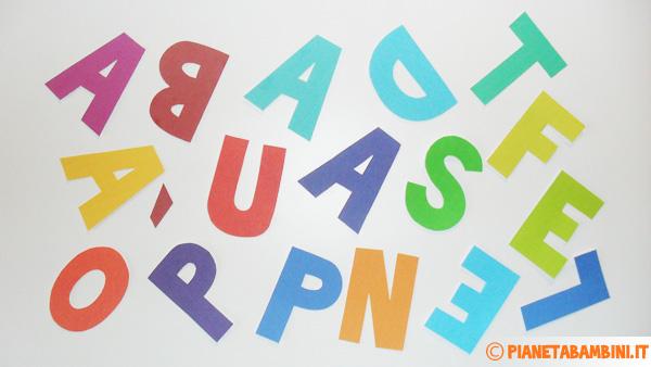 Ritaglio delle lettere che comporranno lo striscione