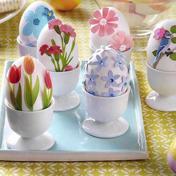 Uova di Pasqua decorate con fiori di carta