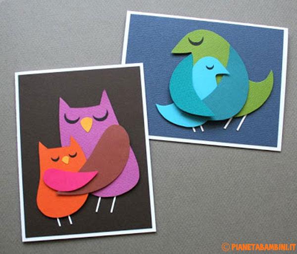 Uccelli di cartoncino che si abbracciano
