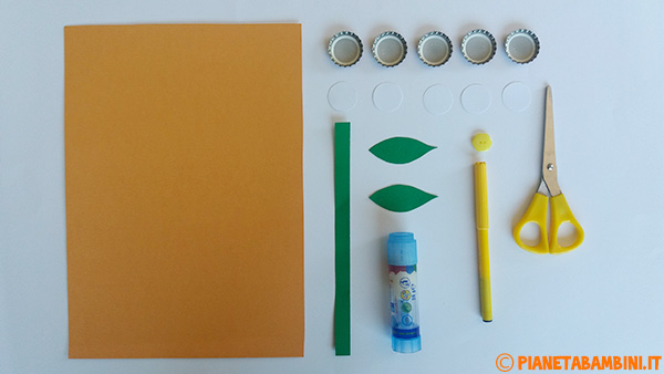 Occorrente per la creazione del fiore con tappi, cartoncino e bottone