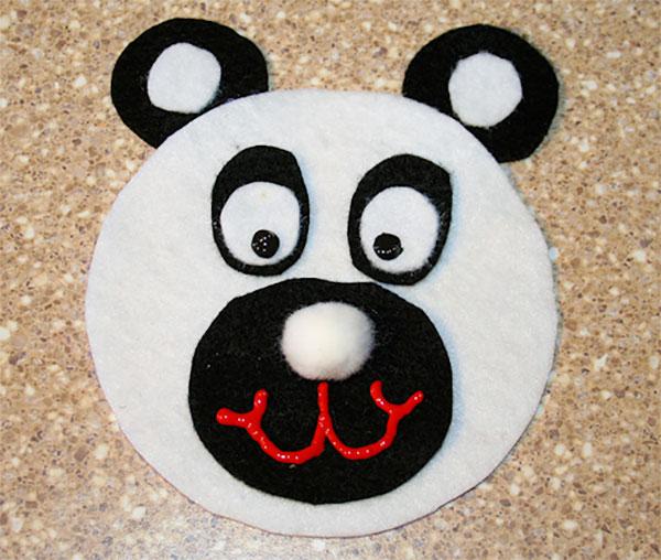 Come creare un panda con CD riciclati