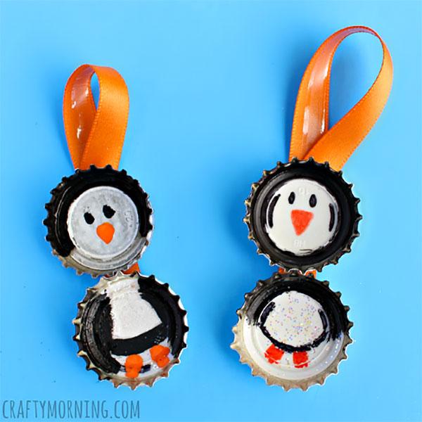 Come creare dei pinguini con tappi di metallo