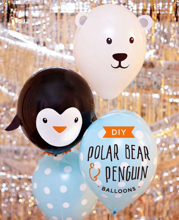 Pinguino e orso polare creati con palloncini