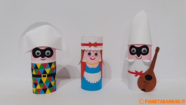 Arlecchino Colombina e Pulcinella creati con rotoli di carta come lavoretto di Carnevale
