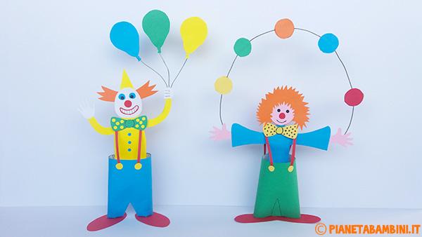 Pagliacci creati con cartoncini e rotoli di carta come lavoretto di Carnevale