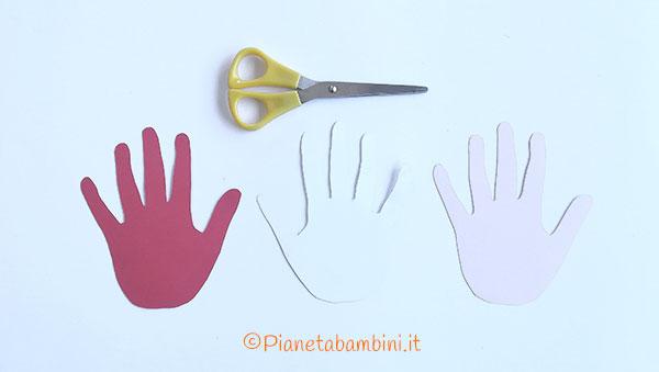 Come ritagliare le sagome delle mani per creare dei fiori di cartoncino