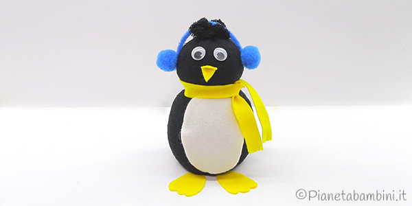 Lavoretto pinguino con calzino, riso e feltro